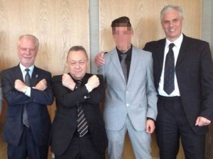 West Ham United co-owners David Gold and David Sullivan give the Hammer salute flanked to the right by crime boss David Hunt